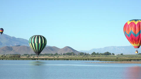Hot air balloon touches water valley lake 4K 061 Footage