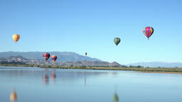 Hot air balloons colorful over mountain valley lake 4K 056 Footage