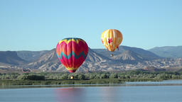 Hot air balloons over valley lake HD 058 Footage