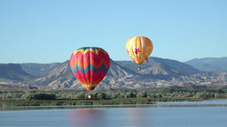Hot air balloons over valley lake 4K 058 Footage