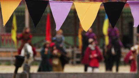 Defocused people in medieval clothes performing traditional dance, singing songs Footage