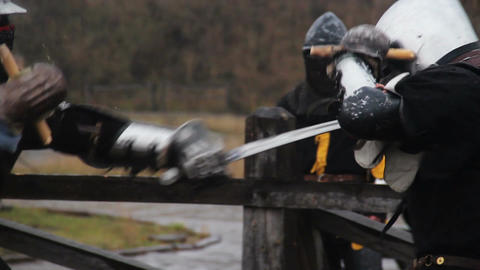 Men wearing medieval knights' suits fighting violently, martial arts tournament Footage