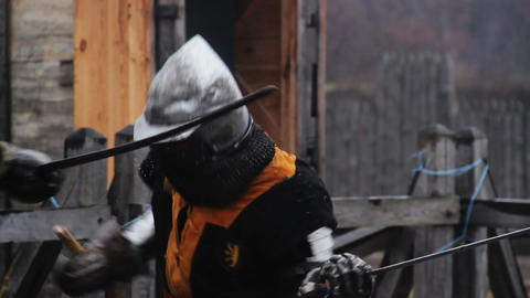 Mighty knight attacking rival with sword during tournament, medieval competition Footage