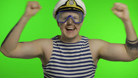 Emotional man tourist in underwater mask, striped sailor shirt dances celebrates Live Action