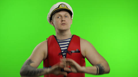 Muscular sailor man works as lifeguard at beach shouts someone, reports danger Live Action