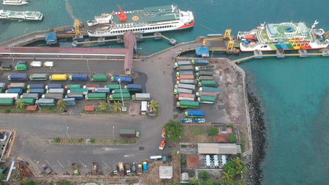 the camera flies over the port Padang Bai port visible large transport ships and Live Action