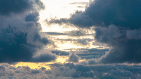 Timelapse - clouds run across the sky against the backdrop of a warm sunset Live Action