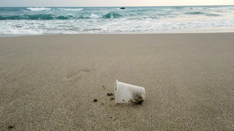 Disposal Plastic glass waste on sandy sea shore,polluted nature,cilento Live Action
