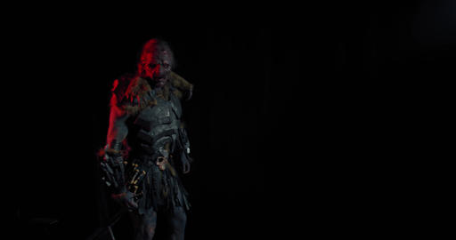 Amazing realistic orc in leather armor is walking and dragging the sword, 4k ライブ動画
