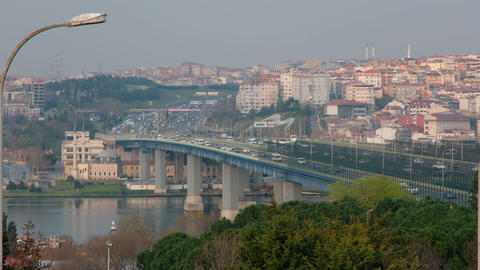 A general view of Halic Bridge which over the Golden Horn in Istanbul. City life, traffic and Live Action