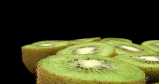 Juicy fresh kiwi fruit super macro close up high quality shoot fly over 4k shoot on dark background Live Action