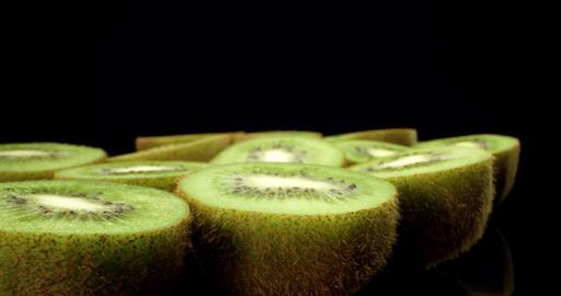 Juicy fresh kiwi fruit 4k super macro close up high quality shoot fly over 4k shoot on dark Live Action