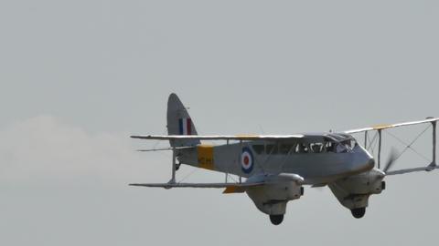 de Havilland DH.89 Dragon Rapide Historic Biplane Airiner Lands Live Action
