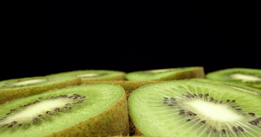 Juicy fresh kiwi fruit cut in half super macro HQ close up shoot fly over shoot on dark background Live Action