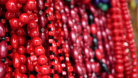 Selection of traditional colorful praying beads chain or rosary on display at a Live Action
