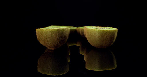 Juicy fresh kiwi fruit cut in half super macro close up high quality shoot fly over 4k shoot Live Action