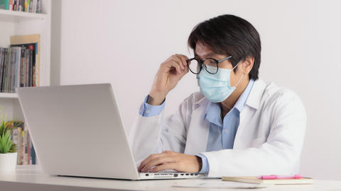 Asian Male Doctor Wear Mask Taking Off Glasses in Serious Emotion Live Action