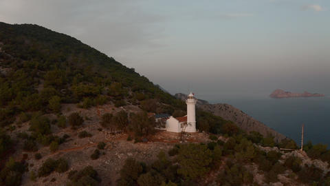 Sea lighthouse on a cape in the open sea Live Action