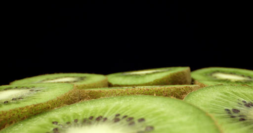 Juicy fresh kiwi fruit cut in half super macro close up shoot fly over shoot on dark background Live Action