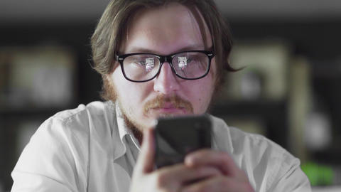Alone manager is working on smartphone at the office Live Action