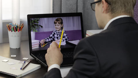 Man teacher making video call on laptop with little pupil. Distance education Live Action