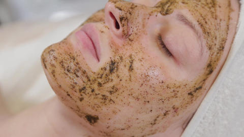 Beautiful woman with a mask on her face in a beauty parlor Live Action