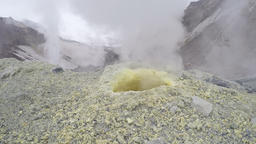 Steaming (smoking) fumarole on thermal field in crater active volcano Footage