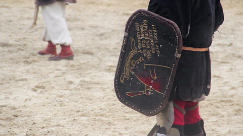 Children wearing historic suits reenacting knights' tournament at theme camp Footage