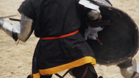 Fierce armed conflict between two mighty knights, medieval fight reenactment Footage