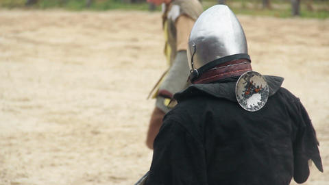 Medieval knights shaking hands with respect, draw a tie in martial competition Live Action