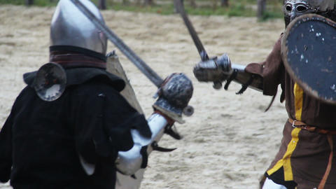 Martial skills competition between two men in medieval armor, attack strategy Footage