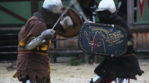Round of sword fight during medieval tournament, men competing in martial skills Footage