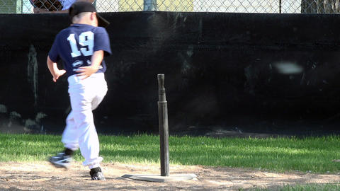 Kids running home t ball baseball game 4K 046 Footage