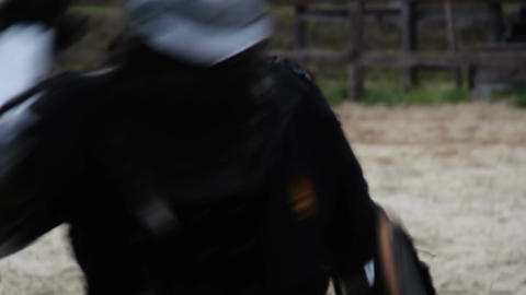 Two male actors wearing knights' armor suits reenacting medieval tournament Footage