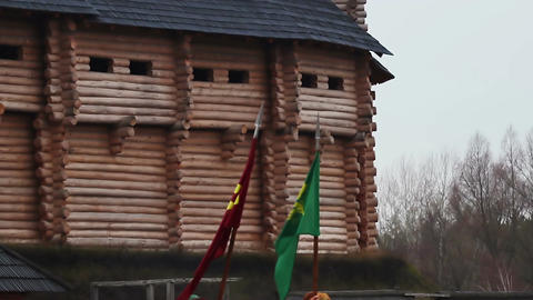 Two flags with coats of arms waving in the wind. View on medieval fortress Footage