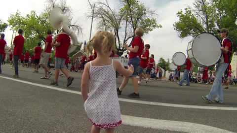 Little girl waves at rural marching band HD 033 Footage