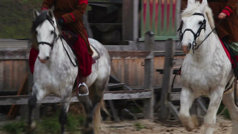 Ancient riders on purebred horses organizing competition on the main street Footage