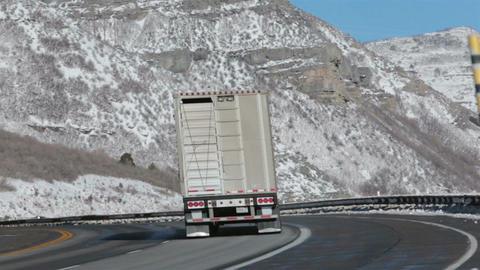 Livestock cattle truck on winter mountain snowy highway HD 0215 Footage