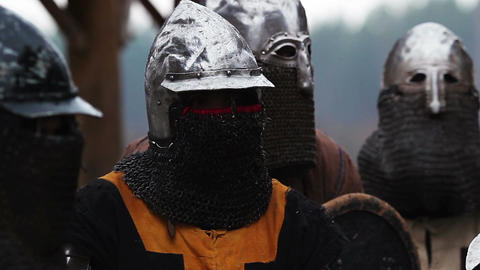 Medieval warriors preparing for battle, knights in armor, historical reenactment Footage