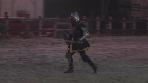 Medieval knights rushing to battle. Evening training before the upcoming fight Footage