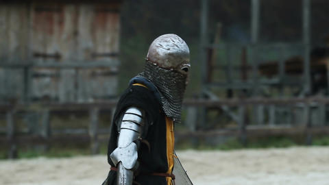 Strong knight comes to battlefield and waits for his rival. Medieval tournament Footage