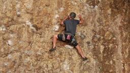 Man climbs rock wall Maple Box Canyon Utah HD 2697 Footage