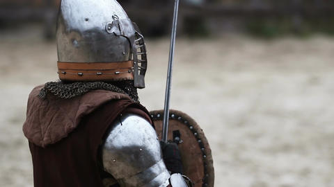 Knight tournament. Two medieval opponents and referee are on the battlefield Footage