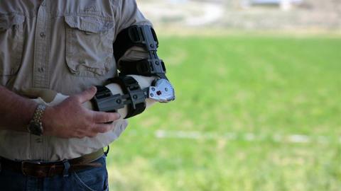 Man in pain arm brace rubbing injury HD 8223 Footage