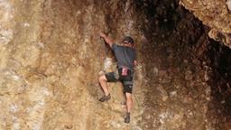 Man rock climbing over hang Maple Box Canyon Utah HD 2699 Live Action