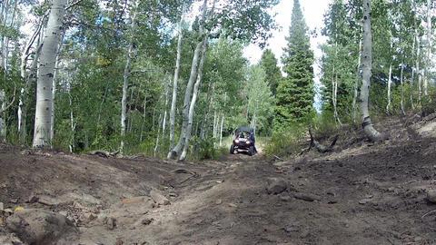 Man on mountain getting in ATV sport utility vehicle HD 0005 ビデオ