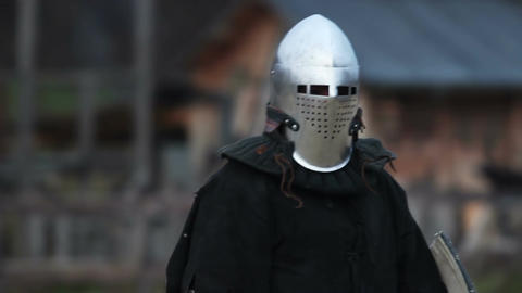 Fearless knight going to the battlefield and expecting his rival. Middle ages Live Action