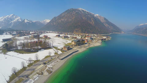 Aerial view, popular resort in Austrian Alps, majestic mountains, deep blue lake Footage