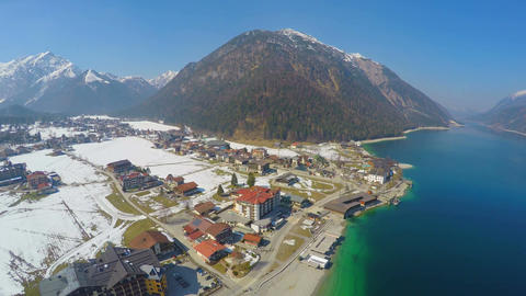 Aerial view of lakeside hotel at mountain bottom, nature, tourism, recreation Footage