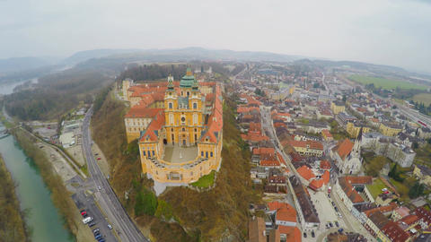Aerial shot of beautiful Melk Abbey in Austria. River Danube. Cold rainy weather Footage